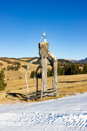 Typical sculpture on the ski slopes of Alpe di Siusi Stock Photo