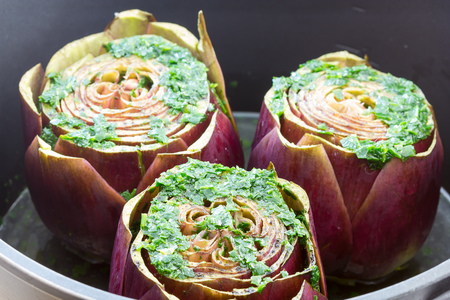 Cook the artichokes in the pan