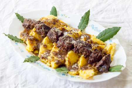 Polenta with wild boar stew Stock Photo