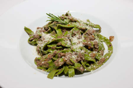Green tagliatelle with game sauce