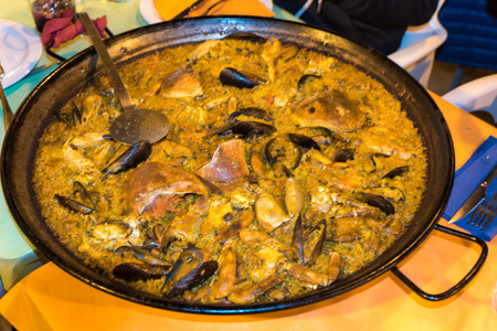 Paella Valenciana with seafood Foto de archivo