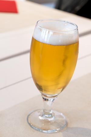 Mug of blonde beer 版權商用圖片