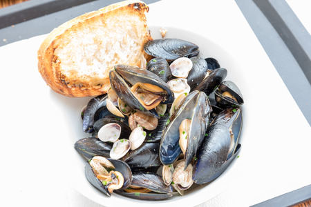 Tasty appetizer peppered mussels Stock Photo