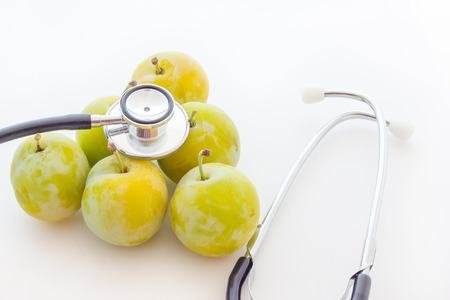 Gold prunes with stethoscope