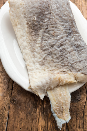 Slice of raw salted codfish