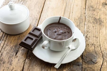 Hot fondant chocolate in the cup Stock Photo - 128780803