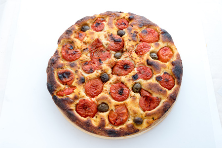 Focaccia typical of Bari Italy with tomatoes and olive