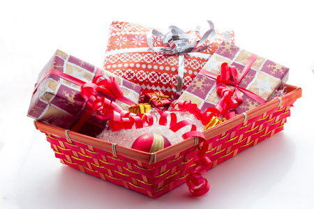 Basket with Christmas gifts Stock Photo