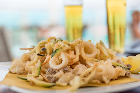 Fried mixed fish with ice-cold beer Stock Photo