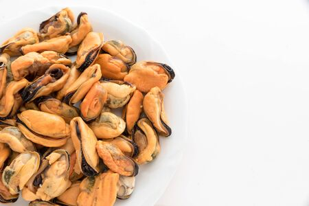 Tasty mussels without hood Stock Photo - 125946329