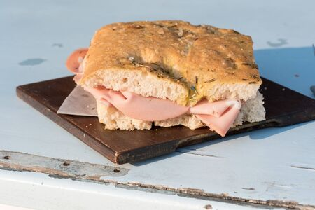 Crescenta with rosemary with mortadella Stock Photo