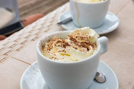 Coffee with cream and cocoa powder Stock Photo