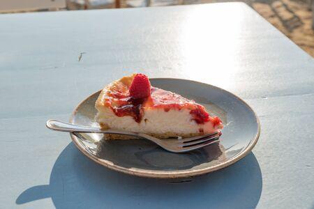 Slice of raspberry semifreddo cake Reklamní fotografie