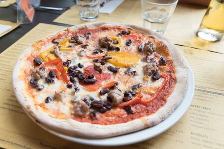 Neapolitan pizza sausage with peppers and mushrooms Stock Photo