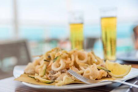 Fried mixed fish with ice-cold beer