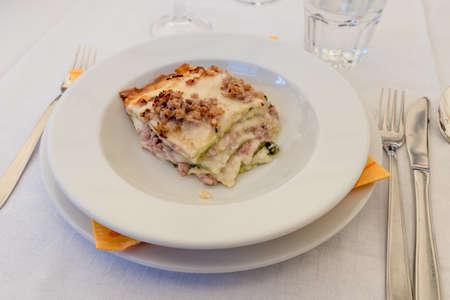 Bolognese lasagne on white plate