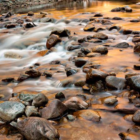 characteristic: Creek at Sunset Stock Photo