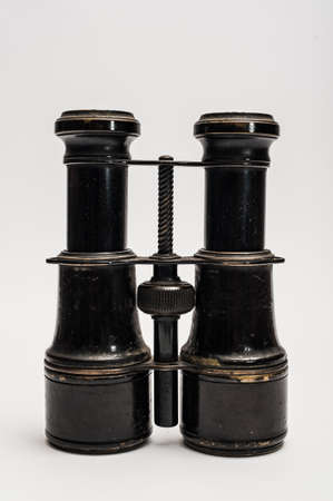 antique binoculars: Vintage binoculars on a white background