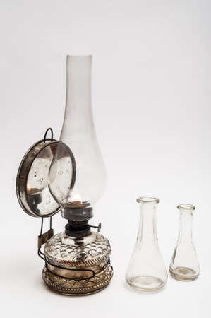 Vintage gas lamp and two old glasses on a white background photo