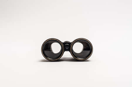 Vintage binoculars on a white background photo