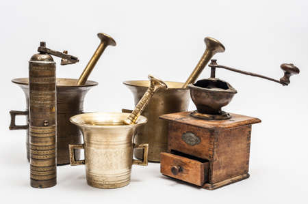 Five vintage grinders on a white background photo