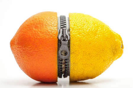 Half orange and half lemon divided by a zipper photo