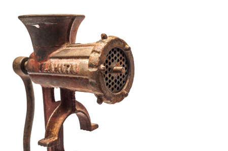 Old worn and rusty meat mincer isolated against a white background photo