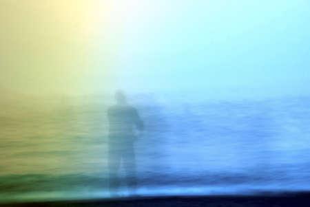spiegelung: Angler am Strand Stock Photo