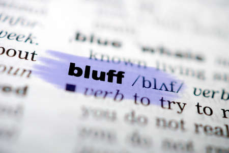 gamblers: Closeup page with text BLUFF in colored highligh Stock Photo