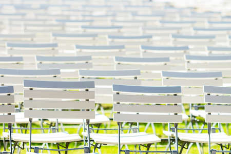 White chair rows in a spa park in bright