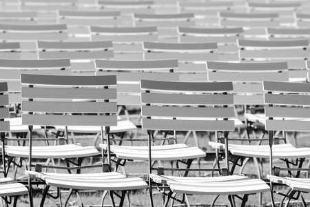 White chair rows in a spa park in Black & White medium light