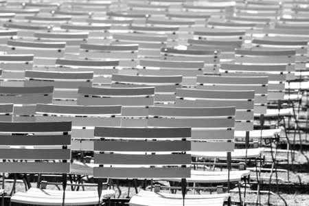 White chair rows in a spa park in Black & White dark