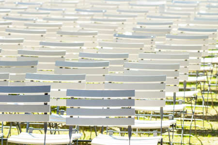 White chair rows in a spa park in dark Stock Photo