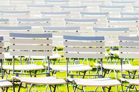 White chair rows in a spa park in medium light