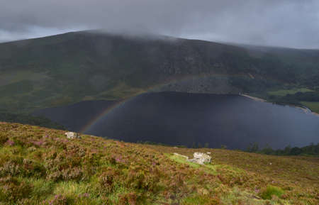 lough: A rainbow spans over Lough Tay in  the Wicklow Mountains near Dublin, Ireland