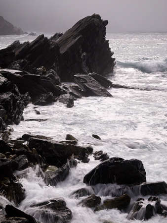 waves crashing: Wild waves crashing against a rock on Dingle peninsula, Ireland