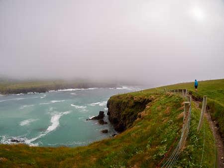Foggy day at Clogher beach, Dingle, Ireland Stock Photo
