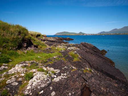 dingle: Rocky coastline in Dingle, Ireland, on a sunny day