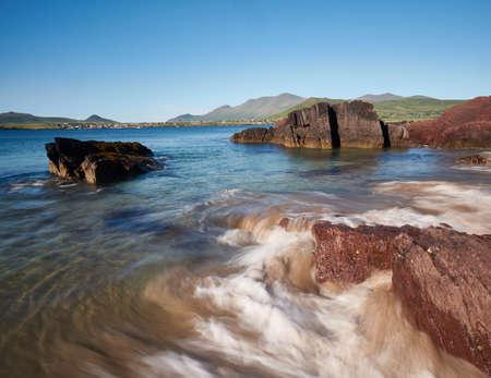 Wild waves crashing against a rock on Dingle peninsula, Ireland