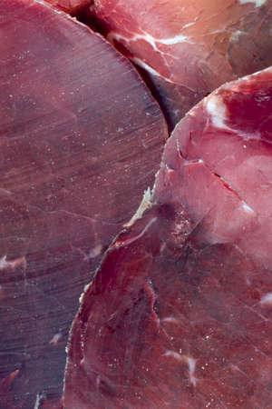 Bresaola cut into slices Stock Photo