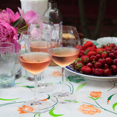 Cold rose wine and fruits photo