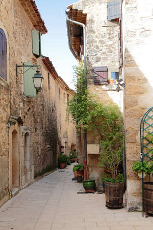 Narrow street in Provence, France photo