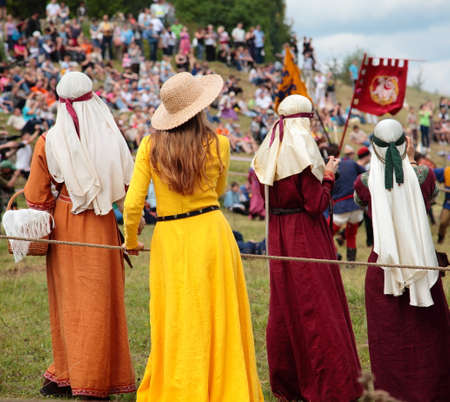 knightly: Girls in medieval costumes watching the knightly tournament in Izborsk, Russia