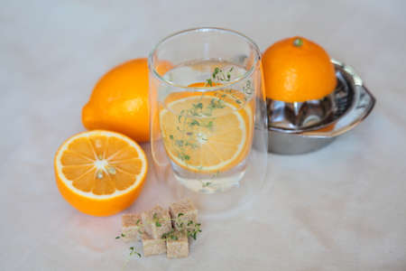 Fresh lemonade with ginger lemons, thyme and cane sugar photo