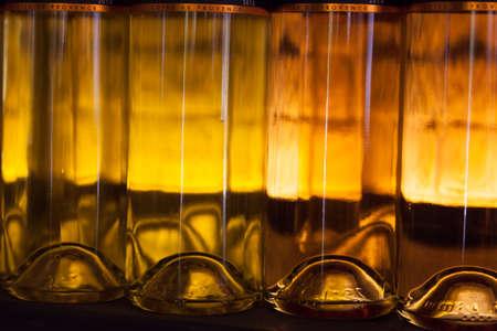 lighted: Row of lighted white wine bottles