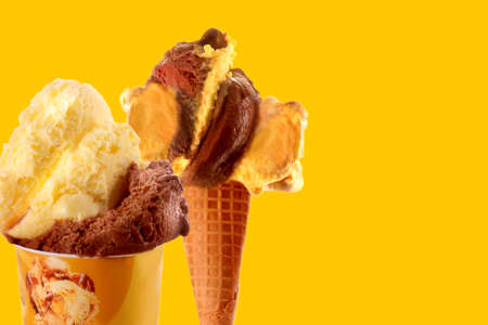 ice cream on cone and in cup takeaway chocolate and cream flavor on a yellow background, space for text