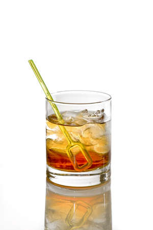 Godfather Cocktail with ice cubes in whiskey glass isolated on white