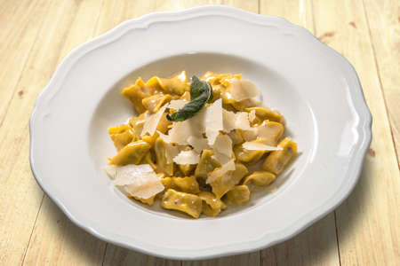 ravioli del plin typical Piedmontese filled pasta from the Langhe in Italy seasoned with butter and sage and parmesan