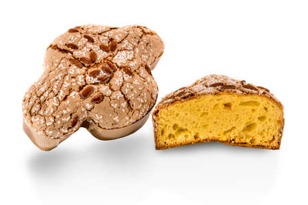 Colomba Pasquale, traditional Italian Easter dove with glazed sugar and almonds on top. One whole and one cut cake isolated on white