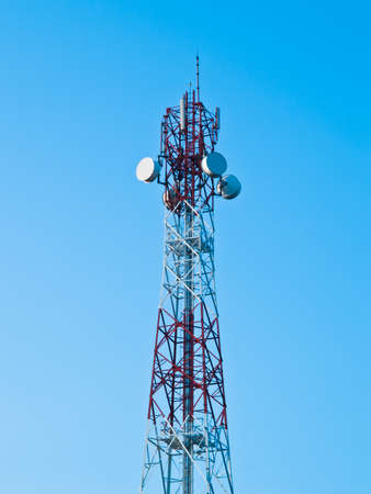 telephone pole: Mobile phone communication repeater antenna tower in blue sky